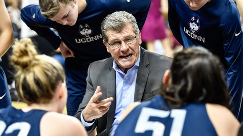 Connecticut head coach Geno Auriemma gives instruction to his team during the second half of an NCAA college basketball game, Sunday, Jan. 1, 2017, in Orlando, Fla. Connecticut defeated UCF 84-48. (AP Photo/Roy K. Miller)
