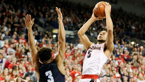 Jan 26, 2017; Spokane, WA, USA; Gonzaga Bulldogs guard Nigel Williams-Goss (5) goes up for a basket against San Diego Toreros guard Olin Carter III (3) during the first half at McCarthey Athletic Center.  (James Snook-USA TODAY Sports)