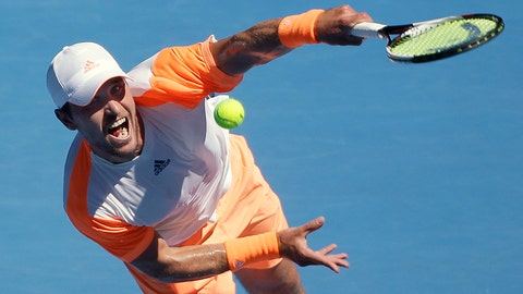 Germany's Mischa Zverev serves to Britain's Andy Murray during their fourth round match at the Australian Open tennis championships in Melbourne, Australia, Sunday, Jan. 22, 2017. (AP Photo/Dita Alangkara)