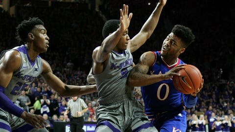 Feb 6, 2017; Manhattan, KS, USA; Kansas Jayhawks guard Frank Mason III (0) controls the ball as Kansas State Wildcats guard Barry Brown (5) defends during the second half at Fred Bramlage Coliseum. The Jayhawks won 74-71. Mandatory Credit: Scott Sewell-USA TODAY Sports
