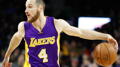 Los Angeles Lakers send Marcelo Huertas to the Houston Rockets for Tyler Ennis