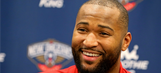 DeMarcus Cousins is wearing panties on his head at a Mardi Gras parade