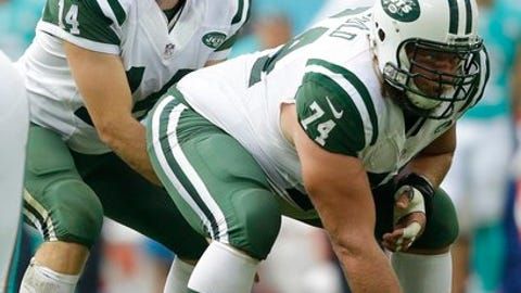 FILE - Sunday, Oct. 4, 2016 file photo, New York Jets' quarterback Ryan Fitzpatrick, left, prepares to take the ball from center Nick Mangold during an NFL football game against the Miami Dolphins at Wembley stadium in London. The New York Jets are placing Nick Mangold on injured reserve with an ankle injury, ending the star center's season and possibly his tenure with the only NFL team he has played for, Thursday, Dec. 8, 2016. (AP Photo/Matt Dunham, File)