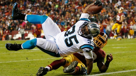 Carolina Panthers fullback Mike Tolbert (35) rolls over Washington Redskins outside linebacker Martrell Spaight (50) for a touchdown during the second half of an NFL football game in Landover, Md., Monday, Dec. 19, 2016. (AP Photo/Alex Brandon)