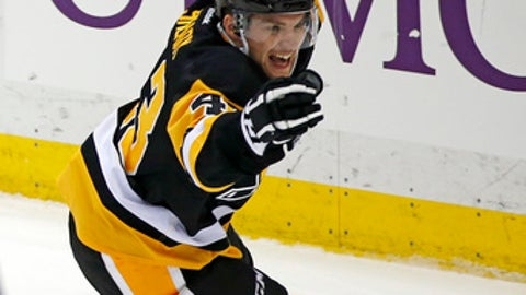 Pittsburgh Penguins' Conor Sheary celebrates his game-tying goal in the last minute of the third period of the team's NHL hockey game against the Montreal Canadiens in Pittsburgh, Saturday, Dec. 31, 2016. The Penguins won 4-3 in overtime. (AP Photo/Gene J. Puskar)