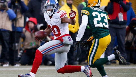 New York Giants wide receiver Victor Cruz (80) runs against Green Bay Packers cornerback Damarious Randall (23) during the first half of an NFC wild-card NFL football game, Sunday, Jan. 8, 2017, in Green Bay, Wis. (AP Photo/Mike Roemer)