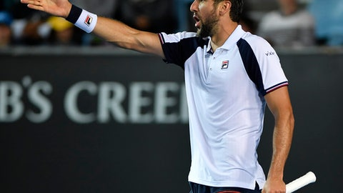 Croatia's Marin Cilic gestures as he questions a line call during his second round match against Britain's Daniel Evans dat the Australian Open tennis championships in Melbourne, Australia, Wednesday, Jan. 18, 2017. (AP Photo/Andy Brownbill)