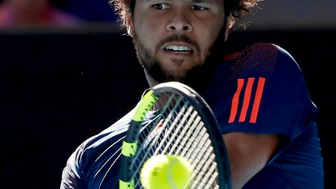 France's Jo-Wilfried Tsonga makes a backhand return to Switzerland's Stan Wawrinka during their quarterfinal at the Australian Open tennis championships in Melbourne, Australia, Tuesday, Jan. 24, 2017. (AP Photo/Kin Cheung)