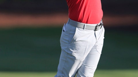 FILE - In this file photo dated Friday, Nov. 18, 2016, Rory McIlroy of Northern Ireland plays a shot on the 2nd hole during the 2nd round of the DP World Tour Championship golf tournament in Dubai, United Arab Emirates. McIlroy has said Tuesday Jan. 24, 2017, he'll be ready to play again soon, and is targeting the Mexico Championship in March 2017, following a rib stress fracture injury.(AP Photo/Kamran Jebreili, FILE)
