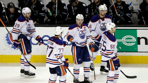 Edmonton Oilers' Connor McDavid (97) celebrates his goal with teammates during the third period of an NHL hockey game against the San Jose Sharks Thursday, Jan. 26, 2017, in San Jose, Calif. Edmonton won 4-1. (AP Photo/Marcio Jose Sanchez)