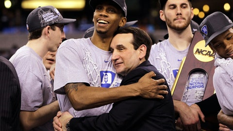 FILE - In this April 5, 2010, file photo, Duke coach Mike Krzyzewski and guard Lance Thomas embrace after Duke's 61-59 win over Butler in the men's NCAA Final Four championship game in Indianapolis. One of the all-time upsets nearly came to be when Gordon Hayward's heave from half court hit the backboard and the front rim before bouncing out at the buzzer to give the Blue Devils a 61-59 victory. (AP Photo/Michael Conroy, File)