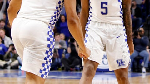Kentucky's Malik Monk (5) and Isaiah Briscoe (13) celebrate during the overtime period of an NCAA college basketball game against Georgia, Tuesday, Jan. 31, 2017, in Lexington, Ky. Kentucky won 90-81 in overtime. (AP Photo/James Crisp)
