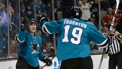 San Jose Sharks' Patrick Marleau, left, celebrates his goal with teammate Joe Thornton (19) during the second period of an NHL hockey game against the Chicago Blackhawks on Tuesday, Jan. 31, 2017, in San Jose, Calif. (AP Photo/Marcio Jose Sanchez)