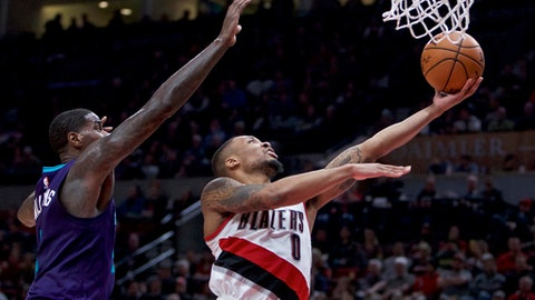 Portland Trail Blazers guard Damian Lillard, right, shoots in front of Charlotte Hornets forward Marvin Williams during the second half of an NBA basketball game in Portland, Ore., Tuesday, Jan. 31, 2017. The Trail Blazers won 115-98. (AP Photo/Craig Mitchelldyer)
