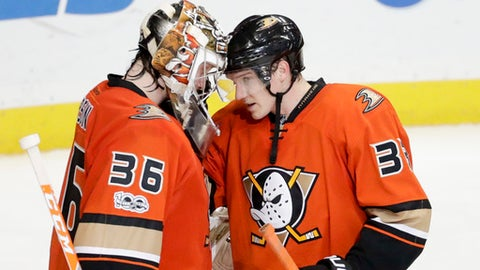 Anaheim Ducks right wing Jakob Silfverberg, right, and goalie John Gibson celebrate after their 5-1 win against the Colorado Avalanche during an NHL hockey game in Anaheim, Calif., Tuesday, Jan. 31, 2017. (AP Photo/Chris Carlson)