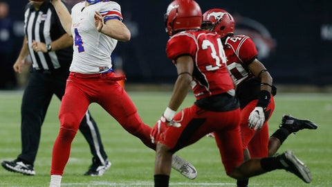 FILE - In this Dec. 19, 2015, file photo, Westlake quarterback Sam Ehlinger (4) rolls out looking for a receiver as North Shore's Leandre Dever (34) and Noah Campbell (40) apply pressure during the Texas UIL 6A Division I state championship football game in Houston. The Longhorns' situation is similar to Georgia's, with Ehlinger stepping in behind a freshman starter. The difference is new coach Tom Herman recruited Ehlinger not Steve Buechele and Ehlinger's mobility could be a better fit in the offense. (AP Photo/Bob Levey, File)
