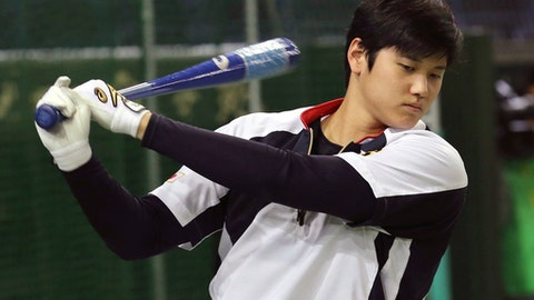 """In this Nov. 12, 2016 photo, Japan's designated hitter Shohei Otani swings during his team's batting practice prior to an international exhibition series baseball game against the Netherlands at Tokyo Dome in Tokyo. Otani says he will not pitch for Japan in next month's World Baseball Classic due to injury, although he may still hit. Otani, who is in Arizona where his team Nippon Ham Fighters are holding a spring camp, said Tuesday, Jan. 31, 2017: """"It would have been difficult in terms of getting ready in time. It's unfortunate but I won't be able to pitch in the WBC."""" (AP Photo/Koji Sasahara)"""