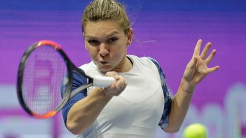 Simona Halep of Romania returns the ball to Ana Konjuh of Croatia during the St. Petersburg Ladies Trophy 2017 tennis tournament match in St.Petersburg, Russia, Wednesday, Feb. 1, 2017. (AP Photo/Dmitri Lovetsky)