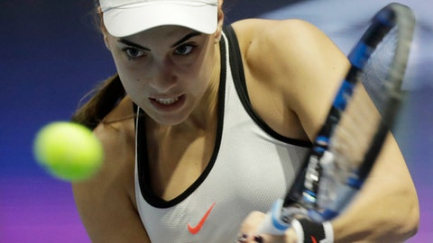 Ana Konjuh of Croatia returns the ball to Simona Halep of Romania during the St. Petersburg Ladies Trophy-2017 tennis tournament match in St.Petersburg, Russia, Wednesday, Feb. 1, 2017. (AP Photo/Dmitri Lovetsky)