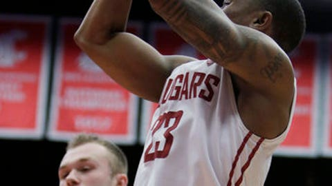 Washington State guard Charles Callison (23) shoots in front of UCLA guard Bryce Alford (20) during the second half of an NCAA college basketball game in Pullman, Wash., Wednesday, Feb. 1, 2017. UCLA won 95-79. (AP Photo/Young Kwak)