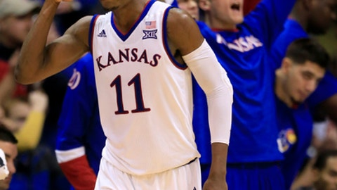 Kansas guard Josh Jackson (11) salutes his teammates after a three-point basket during the second half of an NCAA college basketball game against Baylor in Lawrence, Kan., Wednesday, Feb. 1, 2017. Jackson scored 23 points in the game. Kansas defeated Baylor 73-68. (AP Photo/Orlin Wagner)