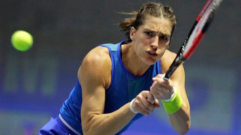 Andrea Petkovic of Germany returns the ball to Roberta Vinci of Italy during the St. Petersburg Ladies Trophy 2017 tennis tournament match in St.Petersburg, Russia, Thursday, Feb. 2, 2017. (AP Photo/Dmitri Lovetsky)