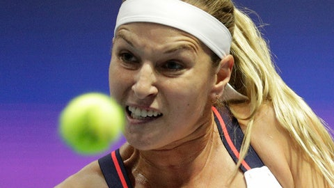 Dominika Cibulkova of Slovakia returns the ball to Donna Vekic of Croatia during the St. Petersburg Ladies Trophy-2017 tennis tournament match in St.Petersburg, Russia, Thursday, Feb. 2, 2017. (AP Photo/Dmitri Lovetsky)
