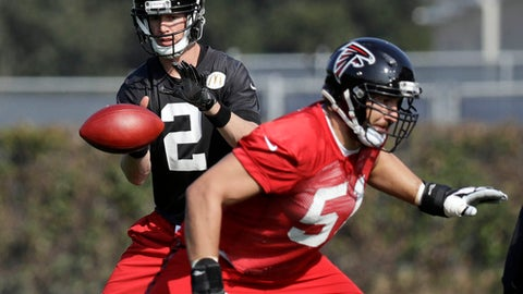 Atlanta Falcons quarterback Matt Ryan (2) takes a snap from center Alex Mack (51) during a practice for the NFL Super Bowl 51 football game Thursday, Feb. 2, 2017, in Houston. Atlanta will face the New England Patriots in the Super Bowl Sunday. (AP Photo/Eric Gay)