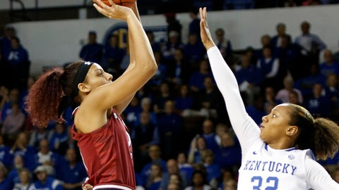 South Carolina's Mikiah Herbert Harrigan, left, shoots while defended by Kentucky's Jaida Roper (32) during the first quarter of an NCAA college basketball game, Thursday, Feb. 2, 2017, in Lexington, Ky. (AP Photo/James Crisp)