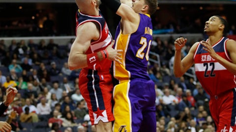 Los Angeles Lakers center Timofey Mozgov (20), of Russia, shoots against Washington Wizards center Marcin Gortat (13), of Poland, during the first half of an NBA basketball game in Washington, Thursday, Feb. 2, 2017. (AP Photo/Manuel Balce Ceneta)