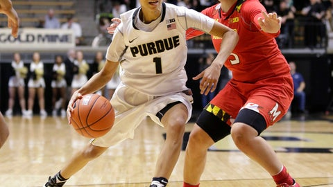 Purdue guard Ashley Morrissette (1) drives on Maryland guard Destiny Slocum (5) during the second half of an NCAA college basketball game in West Lafayette, Ind., Thursday, Feb. 2, 2017. (AP Photo/Michael Conroy)