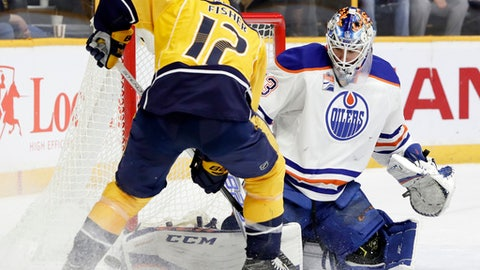 Edmonton Oilers goalie Cam Talbot blocks a shot by Nashville Predators center Mike Fisher (12) during the second period of an NHL hockey game Thursday, Feb. 2, 2017, in Nashville, Tenn. (AP Photo/Mark Humphrey)