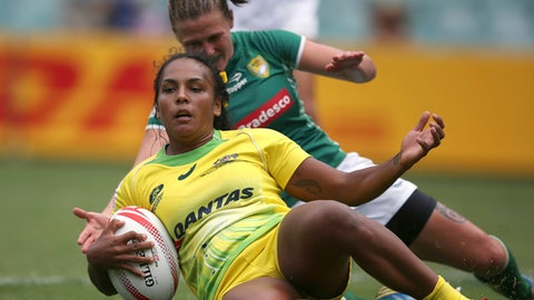 Australia's Mahalia Murphy, front, scores a try as Brazil's Raquel Kochhann attempts to stop the score during their match at the World Rugby Women's Sevens Series rugby tournament in Sydney, Friday, Feb. 3, 2017. (AP Photo/Rick Rycroft)
