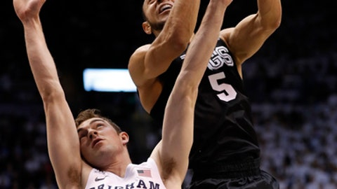Gonzaga guard Nigel Williams-Goss (5) takes a shot against BYU forward Davin Guinn (24) during the first half during an NCAA college basketball game Thursday, Feb. 2, 2017, in Provo, Utah. (AP Photo/Jeff Swinger)