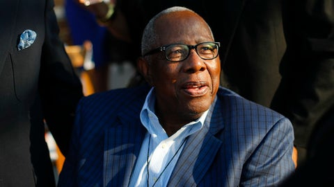 FILE - In this Sept. 24, 2016, file photo, baseball great and Hall-of-Famer Hank Aaron arrives for the dedication ceremony of the Smithsonian Museum of African American History and Culture on the National Mall in Washington.  Aaron is being honored Friday, Feb. 3, 2017, at the Delta Flight Museum in Atlanta, two days before his 83rd birthday. (AP Photo/Pablo Martinez Monsivais, File)