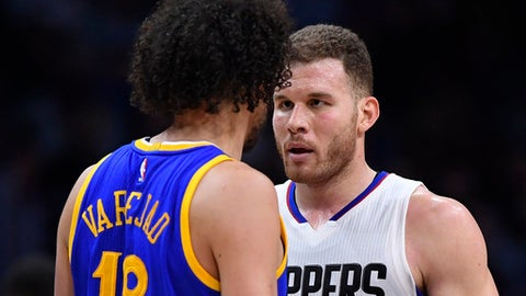 Golden State Warriors center Anderson Varejao, left, of Brazil, and Los Angeles Clippers forward Blake Griffin have words during the second half of an NBA basketball game, Thursday, Feb. 2, 2017, in Los Angeles. (AP Photo/Mark J. Terrill)