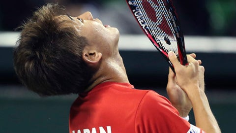 Japan's Yoshihiko Nishioka reacts after he misses a shot against Gilles Simon of France during their Davis Cup World Group first round tennis match in Tokyo, Friday, Feb. 3, 2017. (AP Photo/Koji Sasahara)