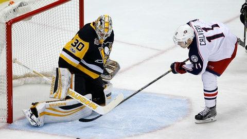 Pittsburgh Penguins goalie Matt Murray (30) stops a shot by Columbus Blue Jackets' Matt Calvert (11) during the first period of an NHL hockey game in Pittsburgh, Friday, Feb. 3, 2017. (AP Photo/Gene J. Puskar)