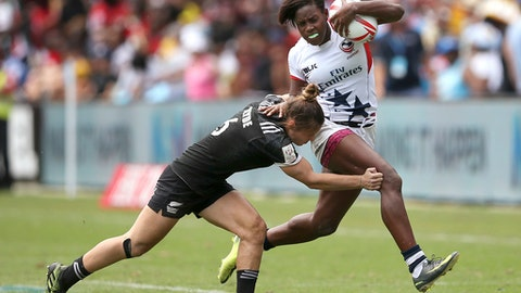 Naya Tapper, right, of the U.S. breaks a tackle of New Zealand's Sarah Goss during their women's semifinal match at the World Rugby Sevens Series tournament in Sydney, Saturday, Feb. 4, 2017. (AP Photo/Rick Rycroft)