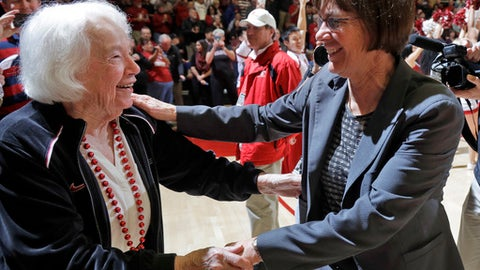 Stanford coach Tara VanDerveer, right, is hugged by her mother, Rita, after her 1,000th career win, in an NCAA college basketball game against Southern California on Friday, Feb. 3, 2017, in Stanford, Calif. (AP Photo/Marcio Jose Sanchez)