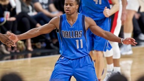 Dallas Mavericks guard Yogi Ferrell reacts after making a basket against the Portland Trail Blazers during the second half of an NBA basketball game in Portland, Ore., Friday, Feb. 3, 2017. (AP Photo/Craig Mitchelldyer)