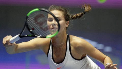 Russia's Natalia Vikhlyantseva returns the ball to France's Kristina Mladenovic, during the St. Petersburg Ladies Trophy-2017 tennis tournament semi final match in St.Petersburg, Russia, Saturday, Feb. 4, 2017. (AP Photo/Dmitri Lovetsky)