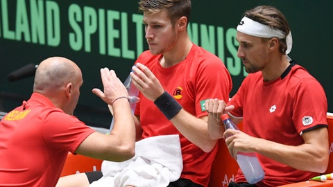 Belgium's  Joris De Loore, center, and Ruben Bemelmans, right, are coached by captain  Johan Van Herck, left, during the Tennis Davis Cup doubles match between Alexander and Mischa Zverev of Germany and Joris De Loore and Ruben Bemelmans of Belgium  in Frankfurt, Germany, Saturday Feb. 4, 2017.  (Arne Dedert/dpa via AP)