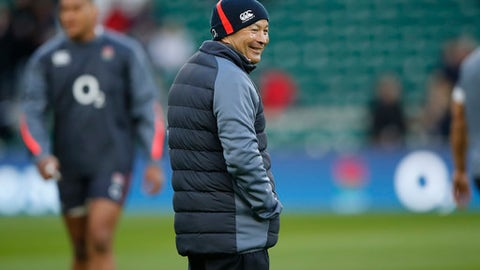 England's head coach Eddie Jones smiles as he watches his team warm up before the Six Nations international rugby union match between England and France, at Twickenham stadium in London, Saturday, Feb. 4, 2017. (AP Photo/Alastair Grant)