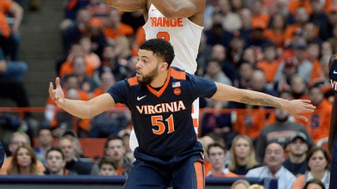 Syracuse guard Andrew White III, top, passes the ball over Virginia guard Darius Thompson during the first half of an NCAA college basketball game in Syracuse, N.Y., Saturday, Feb. 4, 2017. (AP Photo/Adrian Kraus)