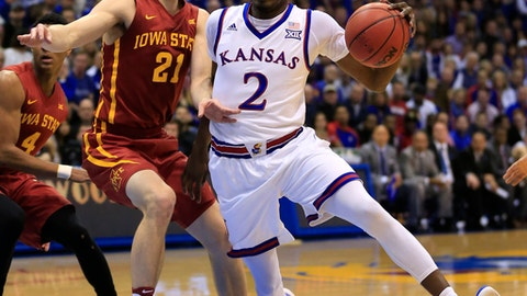 Kansas guard Lagerald Vick (2) drives on Iowa State guard Matt Thomas (21) during the first half of an NCAA college basketball game in Lawrence, Kan., Saturday, Feb. 4, 2017. (AP Photo/Orlin Wagner)
