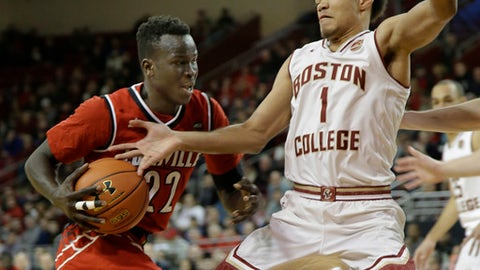 Boston College guard Jerome Robinson (1) can not get his hand on the ball as Louisville forward Deng Adel (22) drives past toward the hoop during the first half of their NCAA college basketball game Saturday, Feb. 4, 2017, in Boston. Louisville defeated Boston College 90-67. (AP Photo/Stephan Savoia)