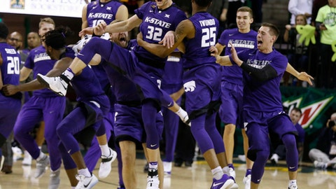 Kansas State forward Dean Wade (32) and forward Wesley Iwundu, right, react to their win over Baylor following an NCAA college basketball game, Saturday, Feb. 4, 2017, in Waco, Texas. (AP Photo/Rod Aydelotte)