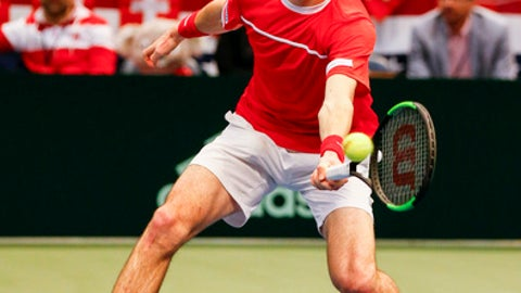 Switzerland's Adrien Bossel returns the ball to United States' Jack Sock and Steve Johnson during a Davis Cup tennis match, Saturday, Feb. 4, 2017, in Birmingham, Ala. (AP Photo/Butch Dill)