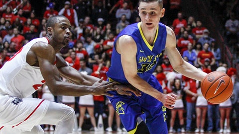 San Jose State's Ryan Welage (32) drives around the defense of New Mexico's Sam Logwood, left, during the first half of an NCAA college basketball game in Albuquerque, N.M., Saturday, Feb. 4, 2017. (AP Photo/Juan Antonio Labreche)